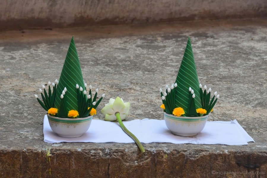 Flower offerings left at Wat Si Chum Temple in Sukhothai, Thailand.