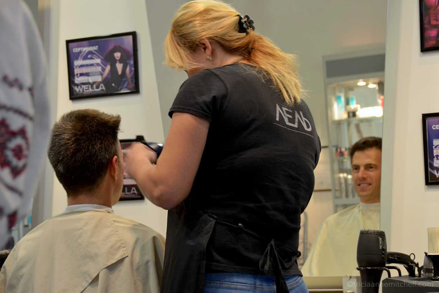 A woman cuts a man's hair in Lviv, Ukraine.