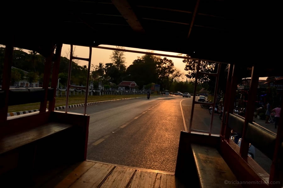 The view from a songthaew (shuttle taxi) in Sukhothai, Thailand at sunset.