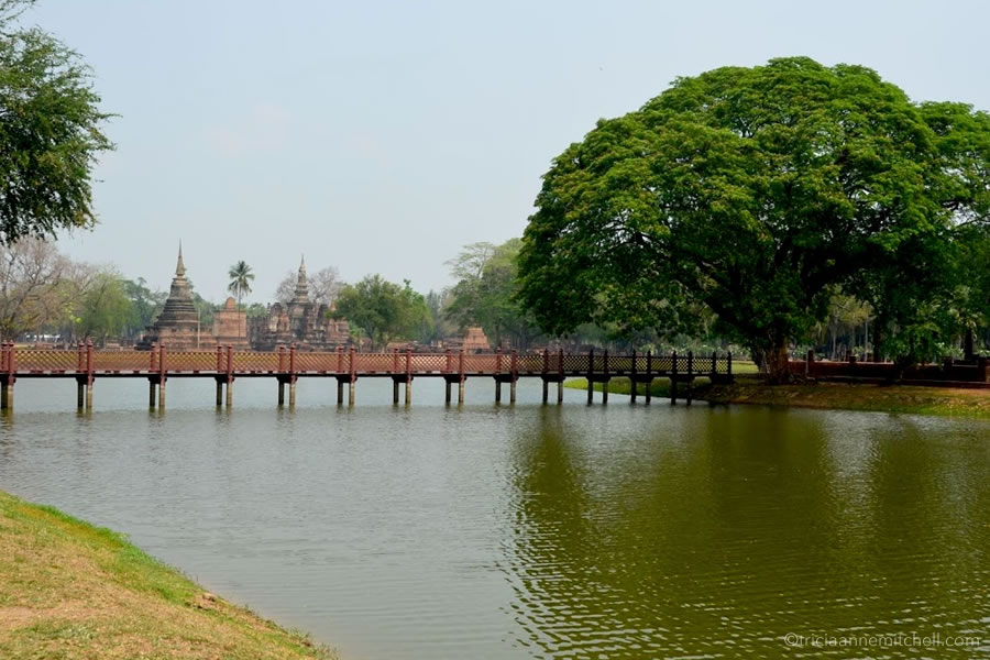 The walkway to Sukhothai's Wat Sa Si Temple in Thailand.