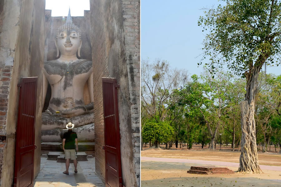 A man looks at the large Buddha figure at Wat Si Chum Temple in Sukhothai, Thailand.