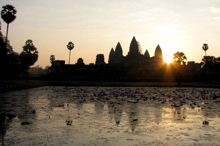 Sun rises over Angkor Wat.
