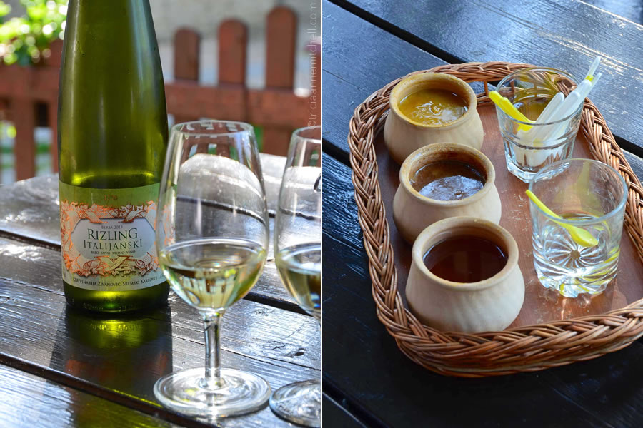 A glass and bottle of wine sit on a table, along with honey, at a honey and wine tasting at the Beekeeping Museum  Živanović Family Winery in Sremski Karlovci, Serbia, near Novi Sad.