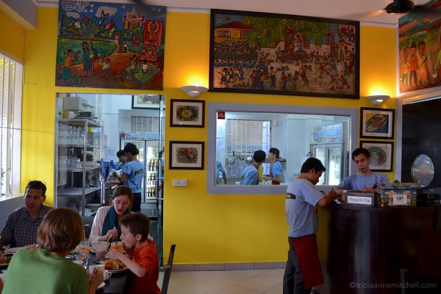 Customers dine inside Friends restaurant in Phnom Penh, Cambodia.
