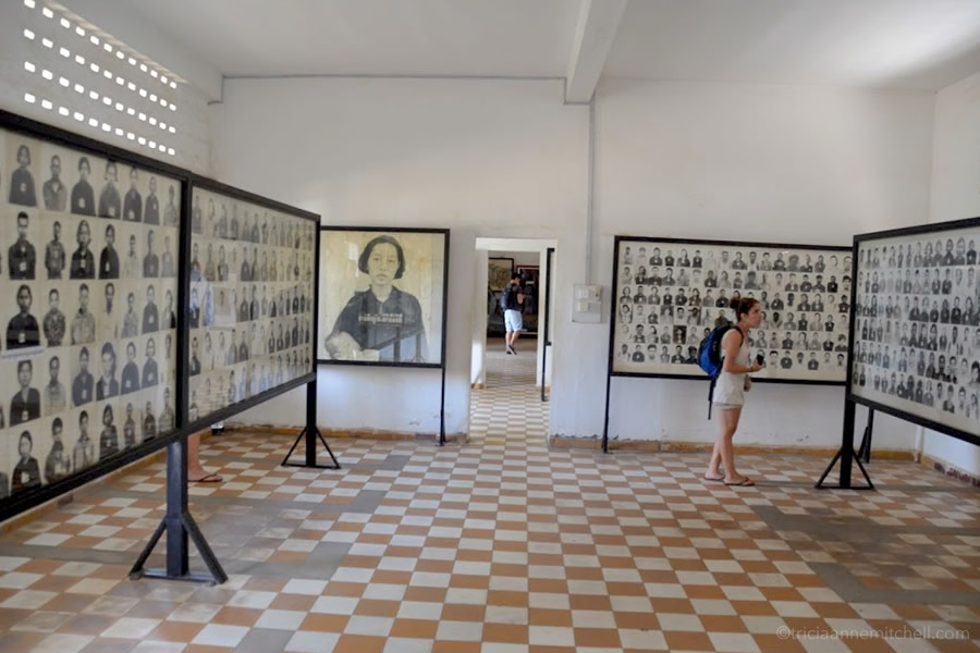 A room at the Tuol Sleng Genocide Museum where black and white images of murdered victims are on display.