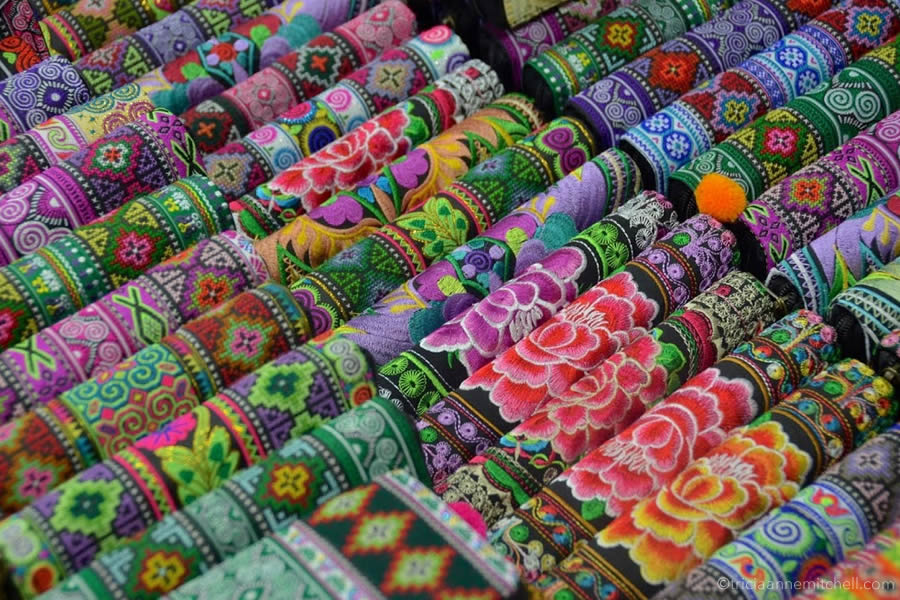 Colorful wallets and purses for sale at a market in Chiang Mai, Thailand.