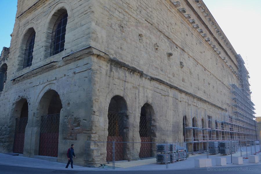The exterior of Orange's Roman Theatre Antique, covered in scaffolding.