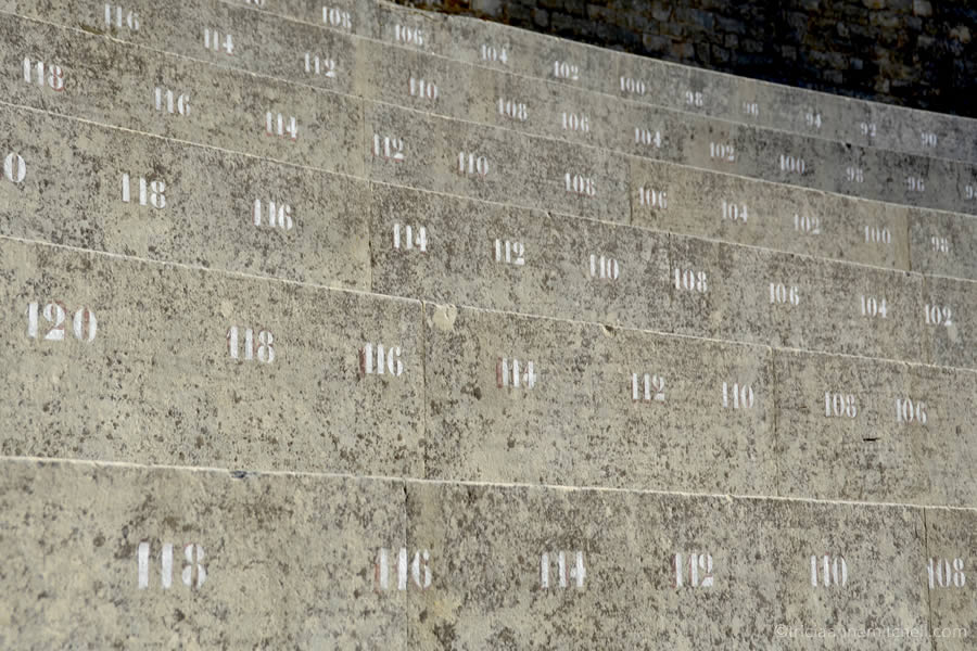 The concrete, steep, numbered seats inside the Theatre Antique in Orange, France.