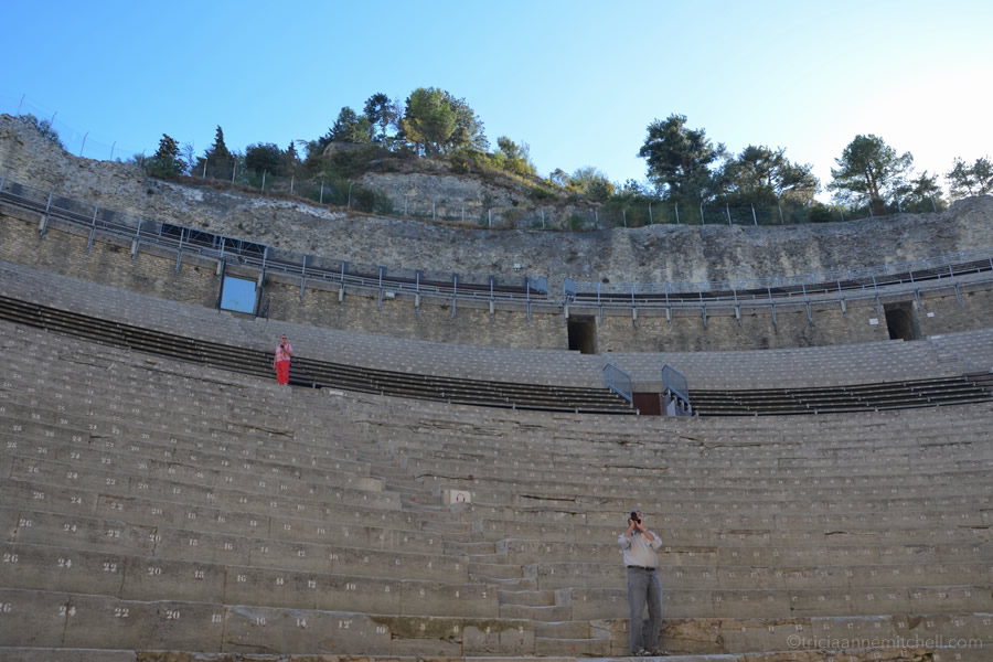 Tourists take photos from the seating area in France's Theatre Antique in Orange.
