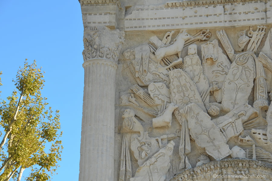A close-up of the architecture of the Roman Arch in Orange, France.