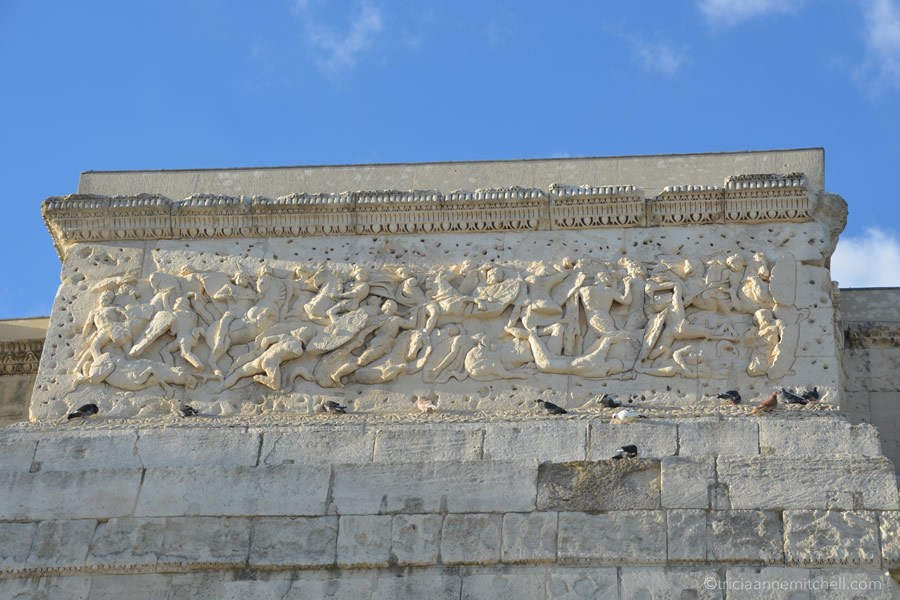 A close-up of the architecture of the Triumphal Arch in Orange, France.