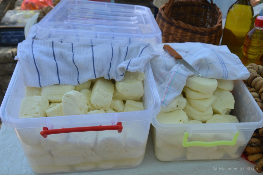 Buckets of fresh, homemade cheese for sale at Virpazar's fresh market, by Lake Skadar, Montenegro.