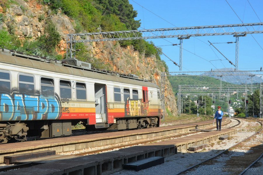 A conductor exits the train near Sutomore, Montenegro.