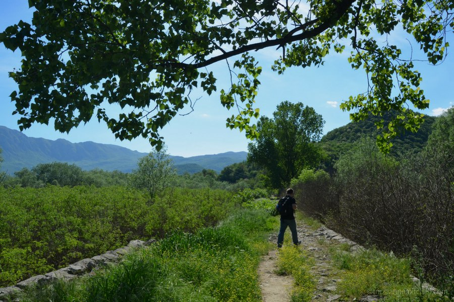 A tourist walks from Virpazar to the train station, near Lake Skadar, Montenegro.