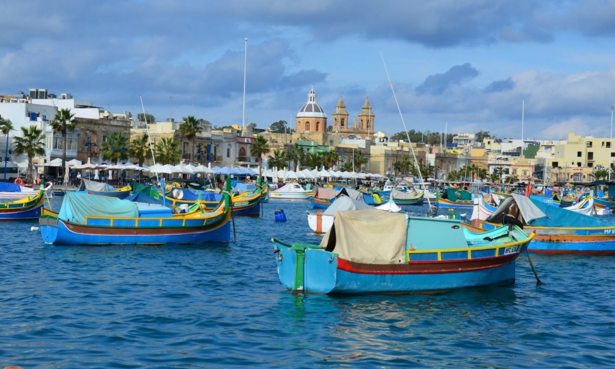 Colorful boats bob in the water off near the fishing town of Marsaxlokk, Malta.