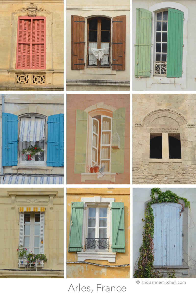 A collage featuring 9 colorful windows in Arles, France. Some are shuttered; others have flowerpots, or laundry adorning them.