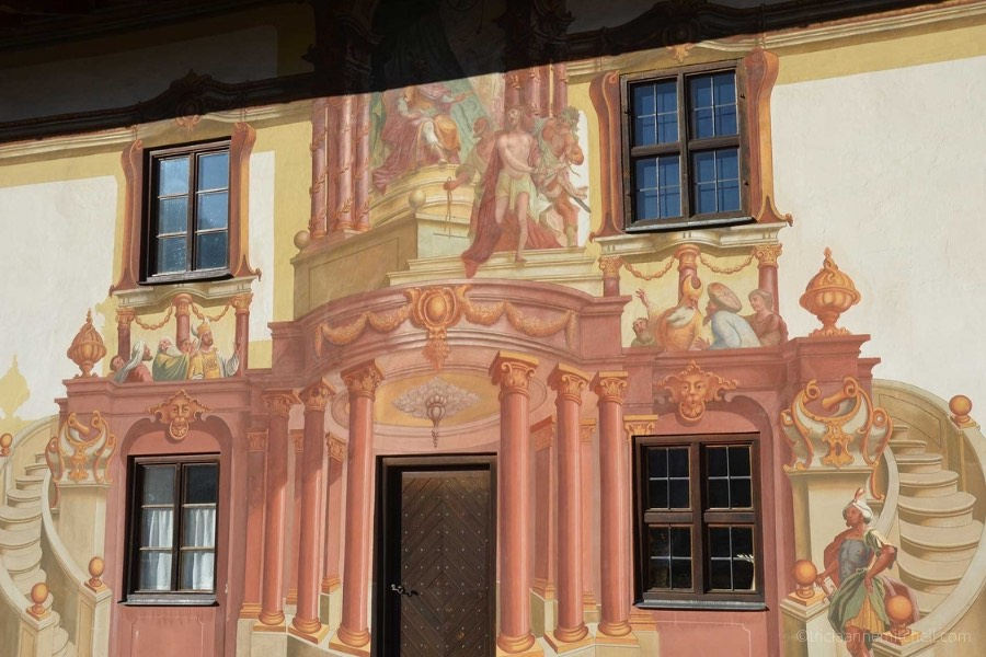 One wall of Oberammergau's Pilatushaus building has paintings depicting a religious scene.