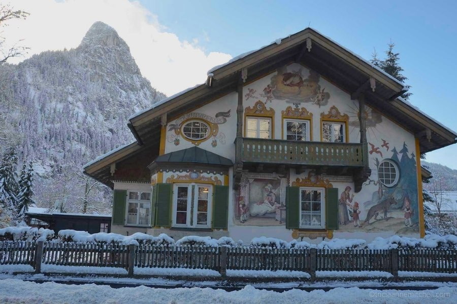 A snow-capped mountain towers over Oberammergau's