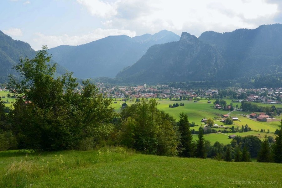 The town of Oberammergau, Germany is visible from a neighboring hill. You can see Oberammergau's