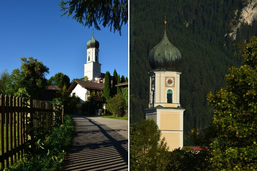 A pale yellow church, with a copper dome resembling an onion, in the German town of Oberammergau.