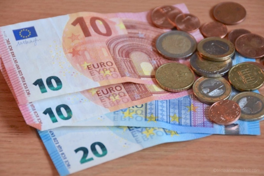 Euro currency is pictured: There are two 10-euro banknotes, as well as a variety of euro coins and cents.