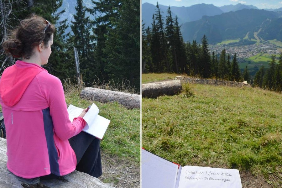 Two pictures taken from the summit of Oberammergau, Germany's Aufacker Mountain. On the left, a woman signs a book while seated on a bench. On the right, you can see an overhead view of a village, framed by mountains.