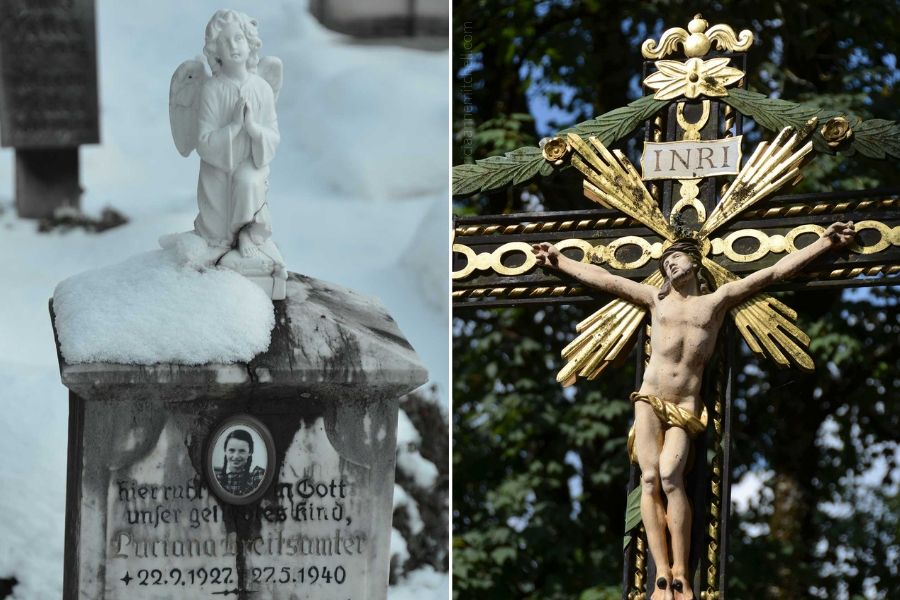Two different headstones from the Oberammergau Cemetery are pictured. One features a white angel on a grey headstone. The other grave marker features Jesus on a crucifix.