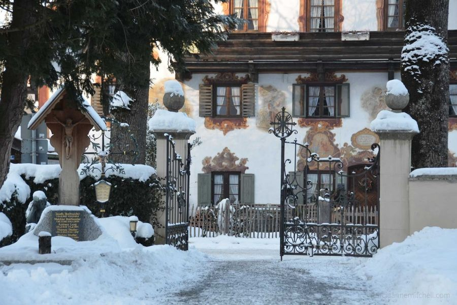 The gated entrance to Oberammergau's cemetery is covered in snow.