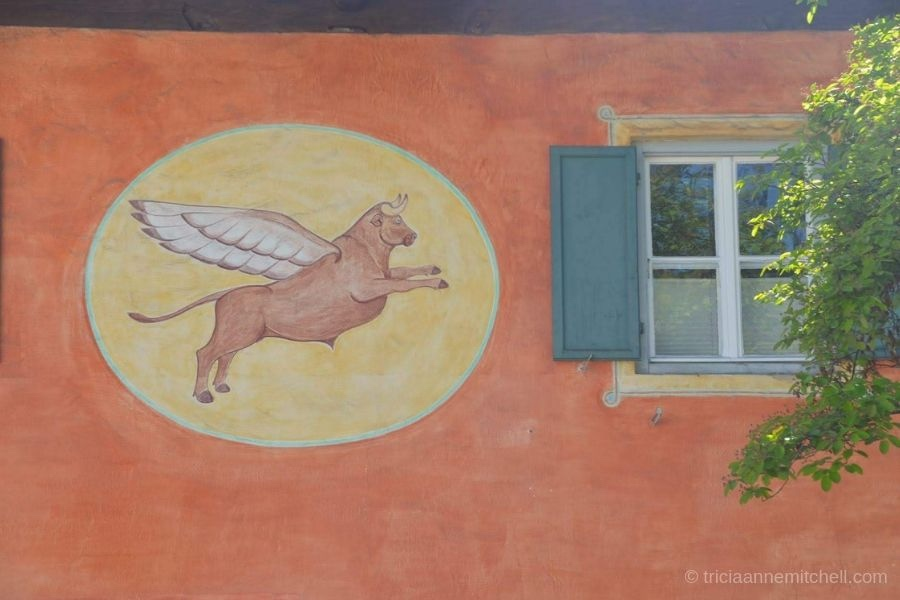 An Oberammergau, Germany building is painted with the likeness of a flying cow.
