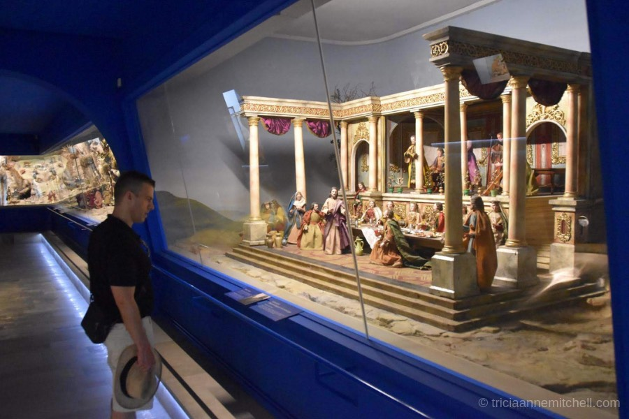 Antique nativity scenes and cribs on display inside the Oberammergau Museum.