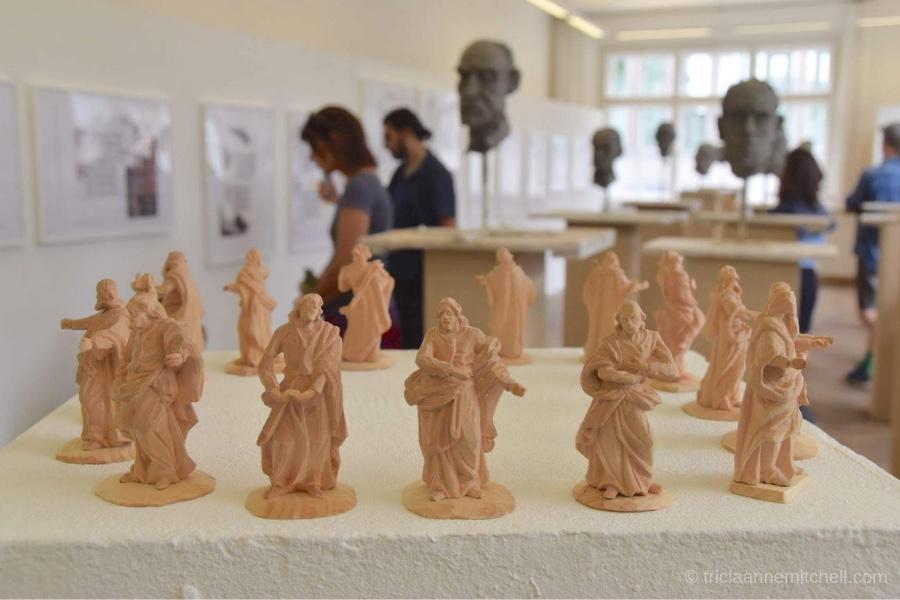 Baroque woodcarvings depicting saints on display inside Oberammergau's Woodcarving School.