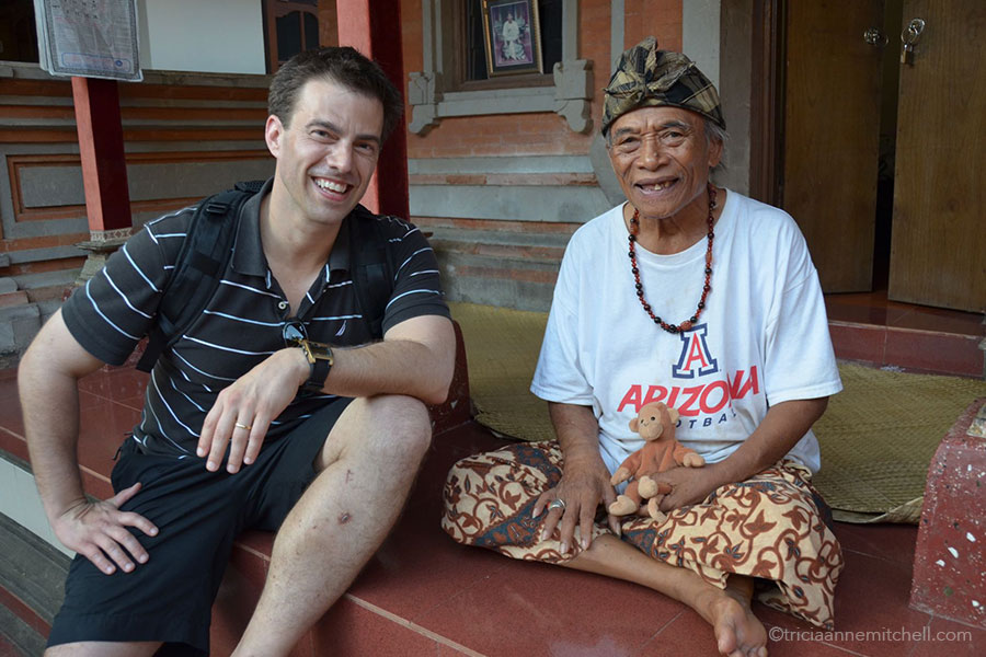 Ketut Liyer meets with a visitor at his home.
