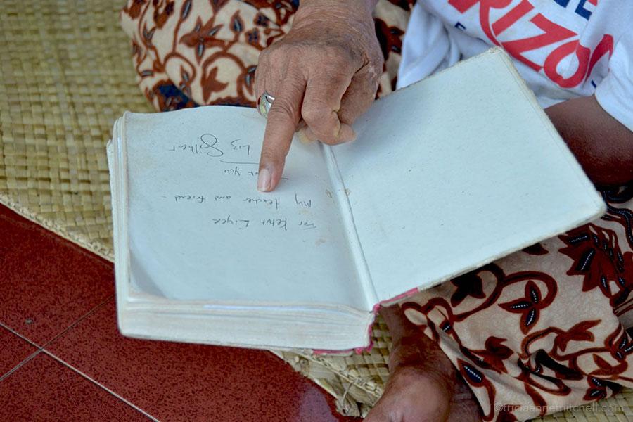 Ketut Liyer holds Elizabeth Gilbert's book.