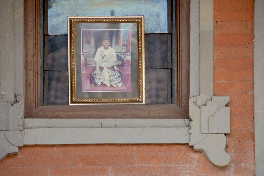 Ketut Liyer's photograph hangs on the outside of a window in his home's courtyard in Ubud, Bali, Indonesia.