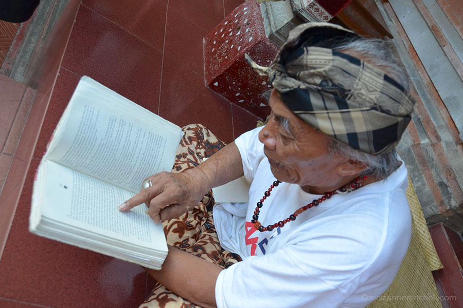 Ketut Liyer points to his name on the page of the book, Eat, Pray, Love.