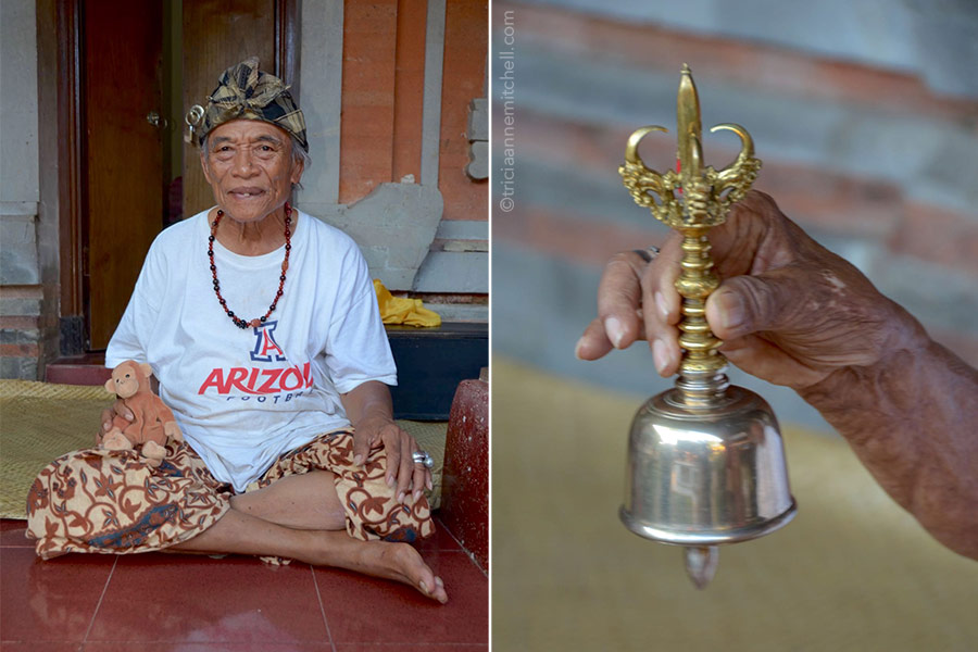 Ketut Liyer sits on his porch outside his home (left) and rings a brass bell (right).