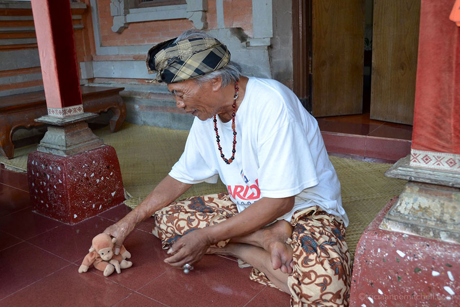 Ketut Liyer, the guru from the book Eat, Pray, Love, holds a stuffed animal outside his home in the city of Ubud, Bali, Indonesia.