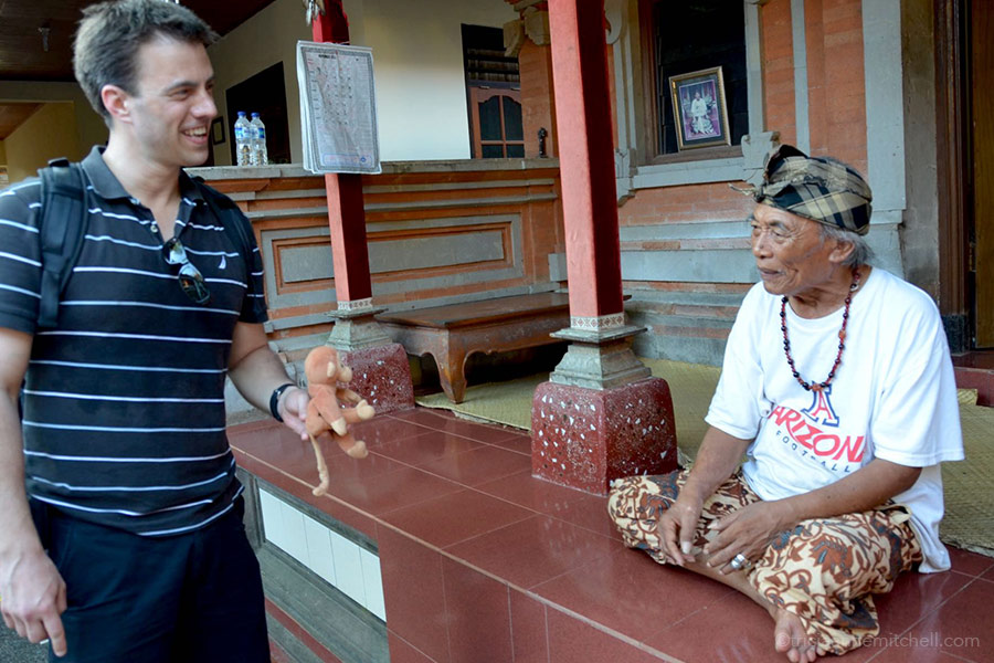 Ketut Liyer, the guru from Eat, Pray, Love, meets with a tourist at his home in Ubud, Bali.