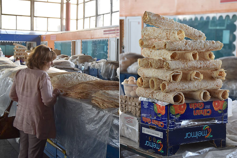 A customer looks at lavash for sale at the GUM Market in Yerevan, Armenia.