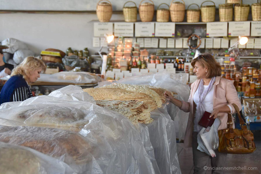 The lavash section of Yerevan's GUM market consists of tables of lavash covered with clear plastic tarps.