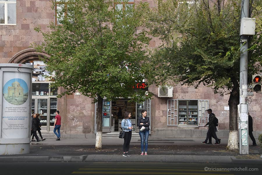 Women stand at a crosswalk in Yerevan, Armenia.