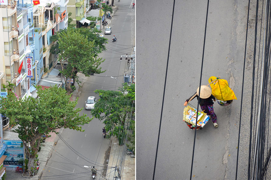 A Vietnamese vendor and motorcyclist proceed down a Nha Trang street.