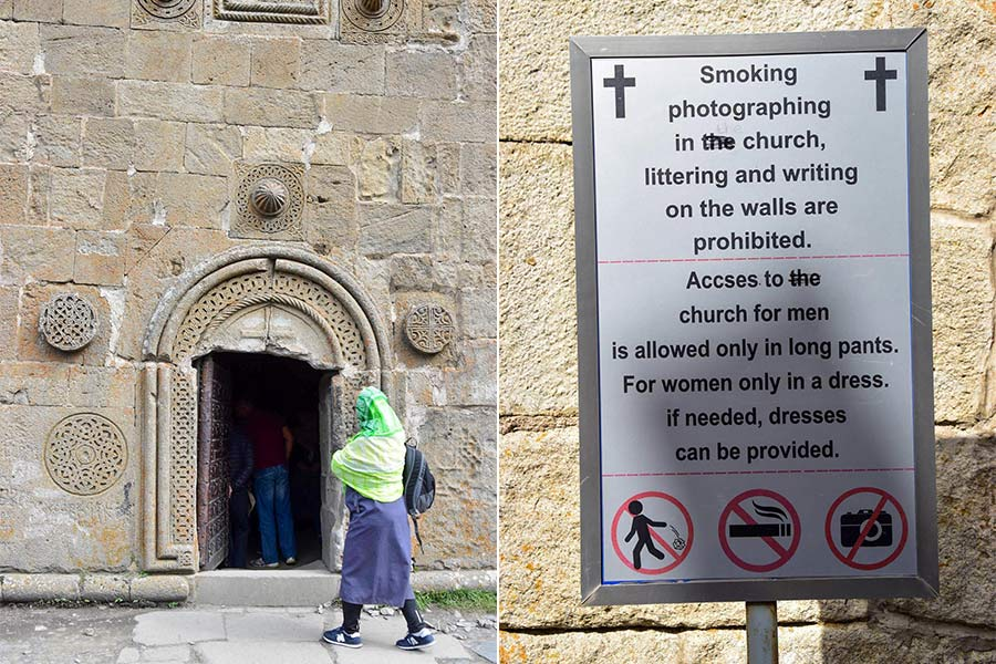 "In the photo on the left, a woman wearing a green headscarf walks past a doorway of the Gergeti Trinity Church in Georgia. On the right, a sign outside the church reads: ""Smoking, photography, littering and writing on the walls are prohibited. Access to the church for men is allowed only in long pants. For women only in a dress. If needed, dresses can be provided. There are also symbols showing that littering, smoking, and photography are not allowed."