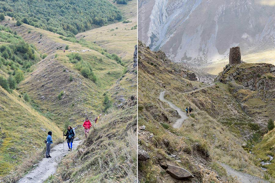 Left: Hikers walk down a path from the Gergeti Trinity Church. You can see a shepherd and his sheep in the background. Right: A pair of hikers is visible in silhouetted form on a curvy dirt path leading past a watchtower in the Caucasus Mountains.